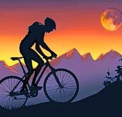 Mountain Biker On Step Hills At Sunset